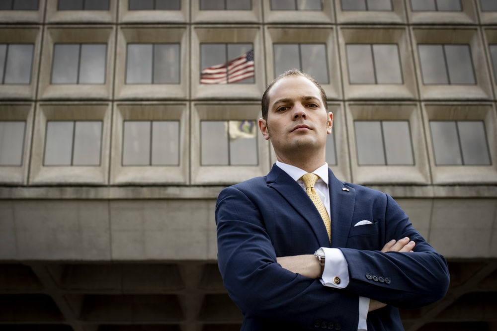 Erik M. Jacobs standing outside of the U.S. Department of Energy building in Washington, DC.